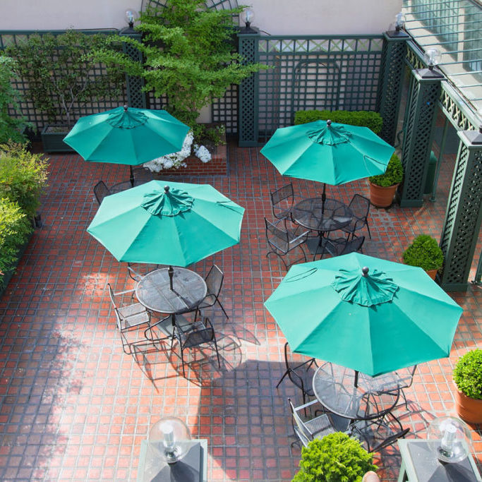 Outdoor Patio Seatings with Tables Chairs and Green Umbrellas